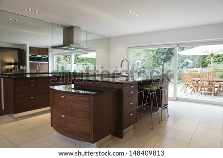 Modern and spacious kitchen with dining area in the porch