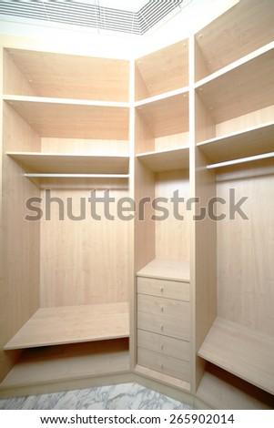 modern and stylish interior of bright wooden wardrobe - stock photo