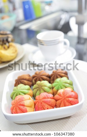 Modern and various flavor of Kuih Bahulu, Malaysia famous traditional muffin (shallow depth of field) - stock photo