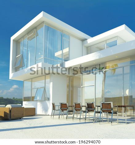 Modern angular whitewashed luxury tropical villa with huge glass windows overlooking a paved patio with an outdoor living area and furniture - stock photo