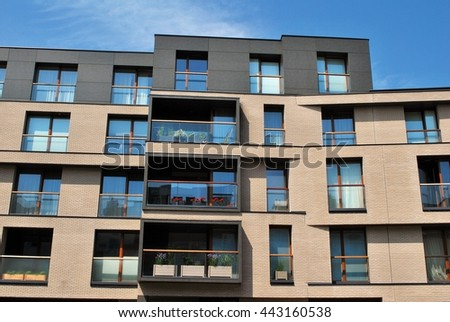 Modern apartment balcony at sunset. - stock photo