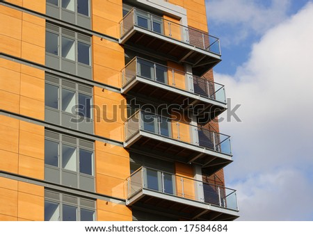 Modern apartment block with wood-effect fascia - stock photo