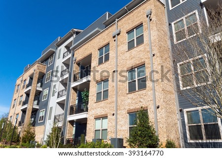 Modern apartment building exterior - stock photo