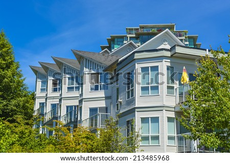 Modern apartment building on sunny day. Residential apartment building in Vancouver, British Columbia. - stock photo