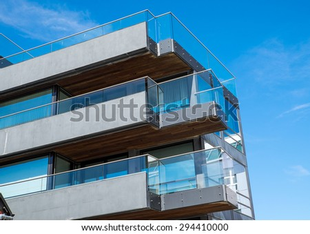 Modern apartment building with big balconies seen in Berlin - stock photo