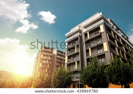 Modern apartment buildings exteriors in sunny day - stock photo