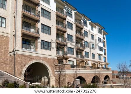 Modern apartment complex building - stock photo