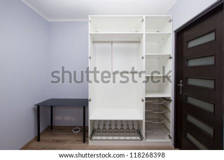 Modern apartment interior with empty white  wardrobe - stock photo