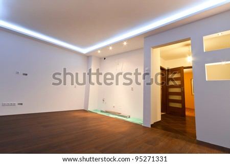 Modern apartment interior with LED ceiling lights - stock photo
