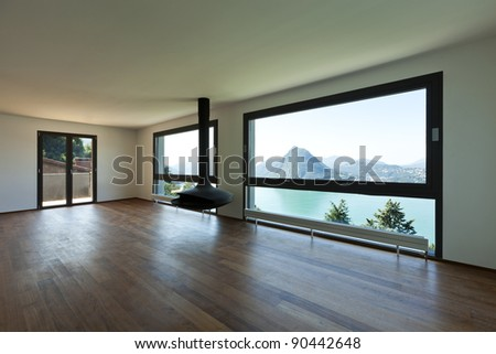 Modern apartment, large living room with panoramic view - stock photo
