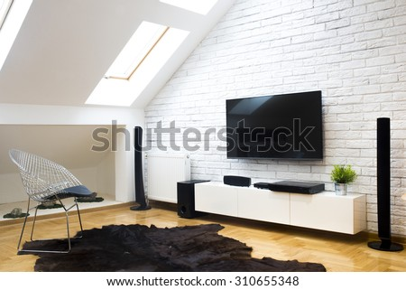 Modern apartment with home theater - stock photo