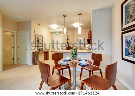 Modern apartment with open floor plan. View of served dining table in dining area