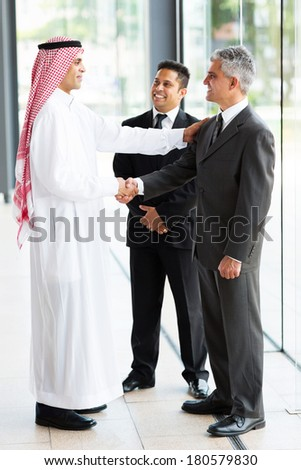 modern arabian businessman greeting business partners - stock photo
