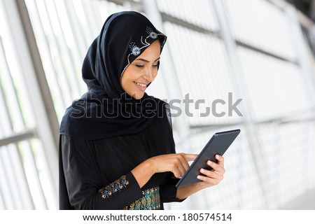 modern Arabian woman with tablet computer  - stock photo