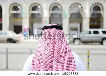 Modern Arabic businessman on street walking - stock photo