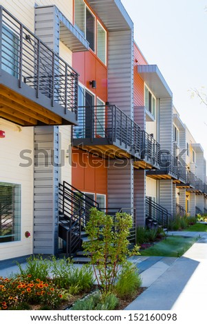 Modern arapartment complex painted in bright colors. - stock photo