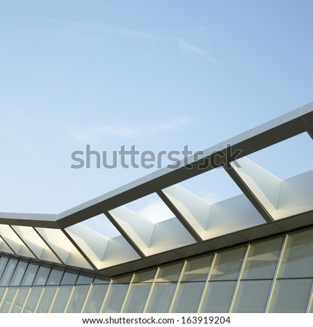 Modern architectural building awning against blue sky - stock photo