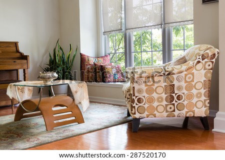 Modern Architectural Home Den Guest Room Interior Design with Elegant Chair, Table, Pillows, Plant and Piano. - stock photo