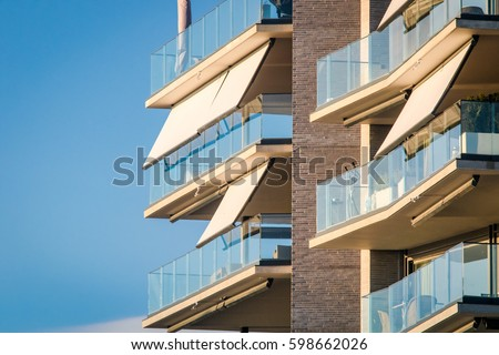 Modern Architecture Windows modern architecture building facade curtains awnings stock photo