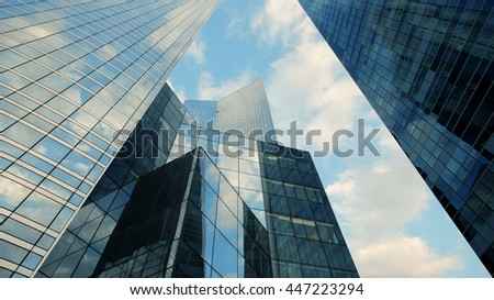 modern architecture buildings exterior background. clouds sky reflection in skyscrapers