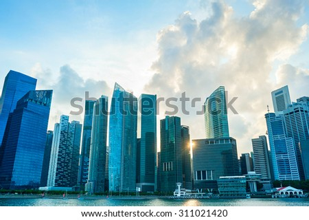 Modern architecture of Singapore Downtown Core at sunset - stock photo