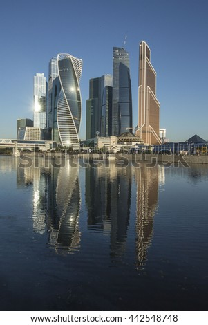 Modern architecture.Skyscrapers reflection in water. early morning. Moscow City.