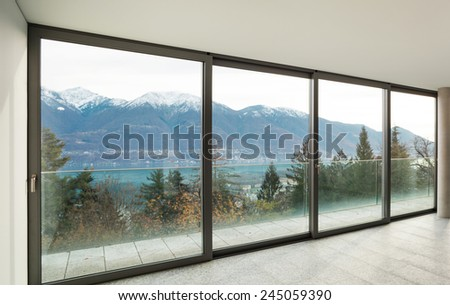 Modern architecture, wide apartment, room with windows - stock photo