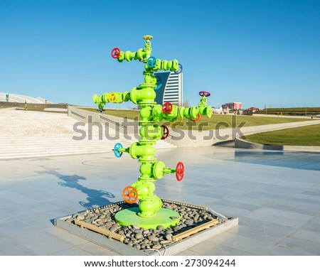 Modern art installation with oil industry piping - stock photo