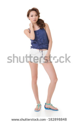 Modern Asian beauty with hot pants, full length portrait isolated on white.