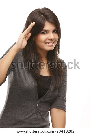 Modern asian girl in a salute expression - stock photo