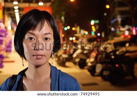 Modern Asian woman in night, closeup portrait in outdoor. - stock photo