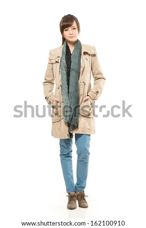 Modern Asian woman with winter coat, full length portrait isolated on white background. - stock photo