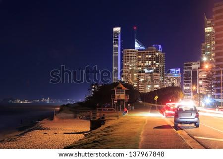 modern australian city at night (main beach,gold coast,qld,australia) - stock photo