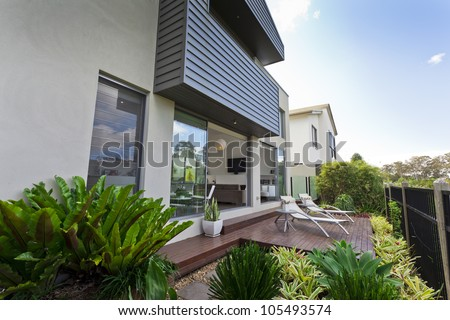 Modern Australian house facade with open living area - stock photo