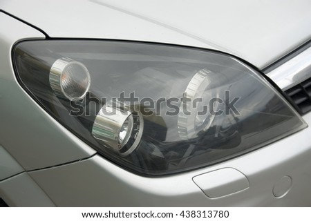 modern automobile headlight close up. Car element. - stock photo