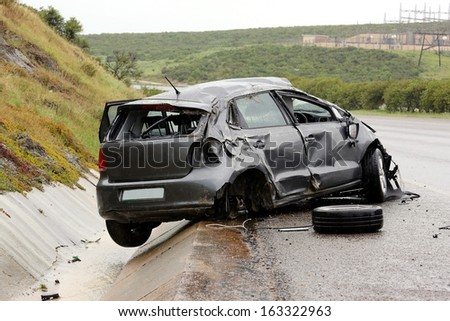 Modern automobile stuck on the road after rolling in the wet weather