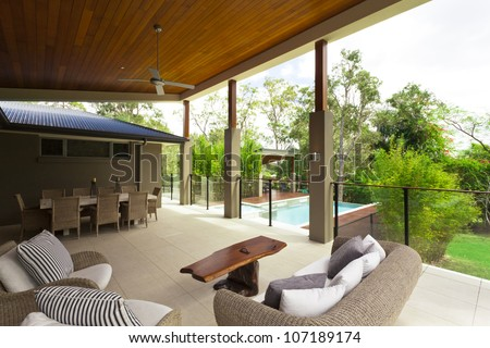 Modern backyard with entertaining area in stylish Australian home - stock photo
