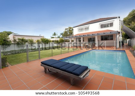 Modern backyard with swimming pool in Australian mansion - stock photo