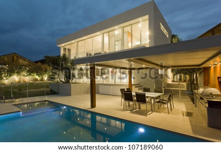Modern backyard with swimming pool in mansion - stock photo