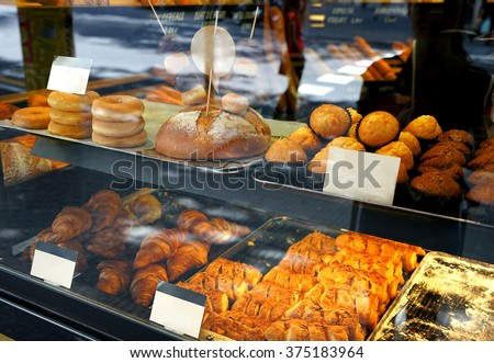 Modern bakery with different kinds of cakes and buns - stock photo