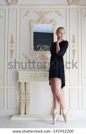 Modern ballet dancer posing, studio shot - stock photo