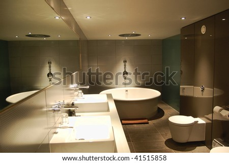 Modern bathroom design in a hotel room - stock photo