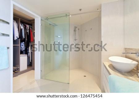 Modern bathroom in stylish Australian home with walk in robe - stock photo