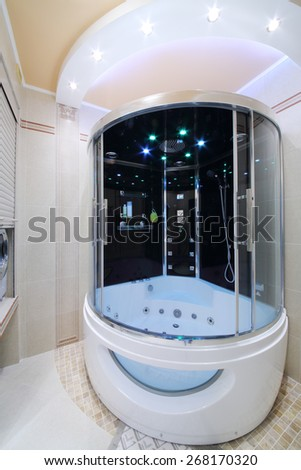 Modern bathroom in the Greek style with outdoor shower cabin - stock photo
