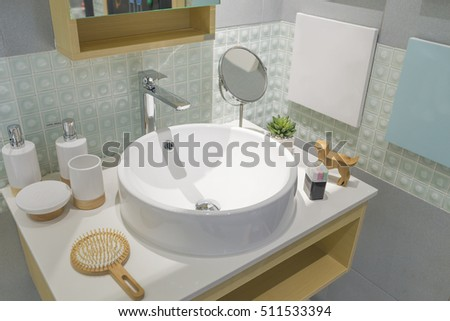 Modern Bathroom interior with ceramic washbasin sink counter and faucet