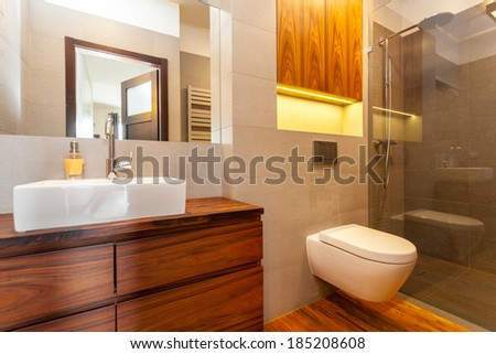 Modern bathroom with a shower and vessel sink - stock photo