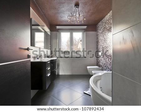 modern bathroom with bathtub and washbasin - stock photo