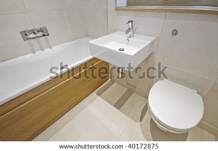 modern bathroom with designer appliances and floor to ceiling tiles