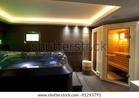 Modern bathroom with jacuzzi bath and sauna - stock photo