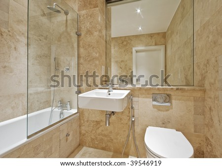 modern bathroom with light brown marble and natural stone tiles